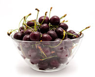 A glass bowl full with sweet cherries  Royalty Free Stock Photography