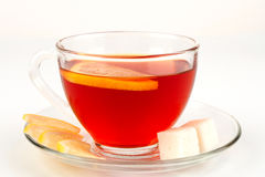 Glass bowl full of tea with pieces of white sugar Royalty Free Stock Photography