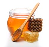 Glass bowl with honey and slice comb Stock Images