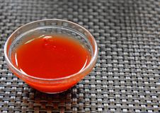 Glass bowl with hot sauce Stock Photography