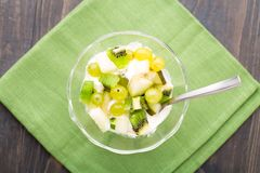 Glass bowl with ice cream and fruits Royalty Free Stock Photos