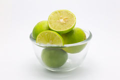 Glass bowl of Limes and slice Stock Photography