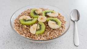 A glass bowl of oatmeal porridge. Healthy breakfast. royalty free stock images