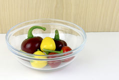 Glass bowl of ornamental peppers Royalty Free Stock Photos