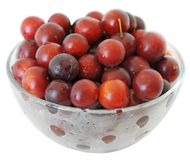 Glass bowl with plums Royalty Free Stock Images