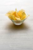 Glass bowl of potato chips Royalty Free Stock Photo