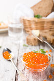Glass bowl with red caviar Stock Images