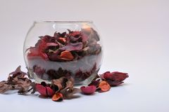Glass Bowl with Red Potpourri spill Royalty Free Stock Image