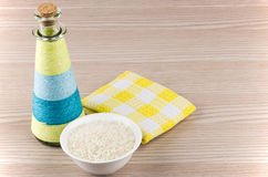 Glass bowl with rice, bottle of oil and napkin Royalty Free Stock Photography