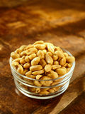 Glass bowl of roasted peanuts or groundnuts Royalty Free Stock Images