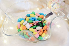 Glass bowl of sugared almonds. At wedding reception Royalty Free Stock Photography