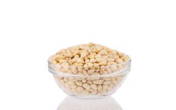 Glass bowl with tasty pine nuts. Royalty Free Stock Photo