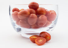 Glass bowl of tomatoes isolated on white Royalty Free Stock Photo