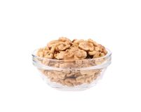 Glass bowl with walnuts. Stock Image