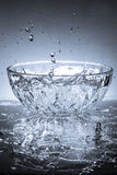 Glass Bowl and water Royalty Free Stock Image