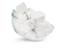 Glass bowl of white marshmallows on a white background royalty free stock image