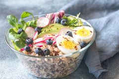 Bowl of wild rice with avocado, egg and lettuce. Glass bowl of wild rice with avocado, egg and lettuce stock image