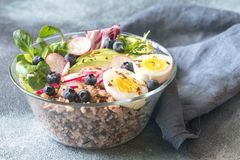 Bowl of wild rice with avocado, egg and lettuce. Glass bowl of wild rice with avocado, egg and lettuce stock photo