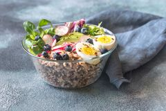 Bowl of wild rice with avocado, egg and lettuce. Glass bowl of wild rice with avocado, egg and lettuce stock images