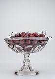 Glass Bowl of Wooden Cherries Royalty Free Stock Photos