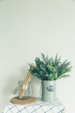 Glass bowl with a wooden spoon, put a fake tree in the little cans, old kitchen Stock Image