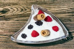Sweet temptation with fresh fruits and biscuits royalty free stock photography