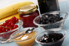 Glass bowls with blueberry and banana jam. On table Stock Photo