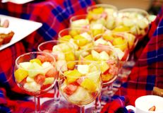 Glass bowls with fresh fruits Stock Image