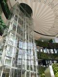 Glass box elevator in modern building Stock Photo