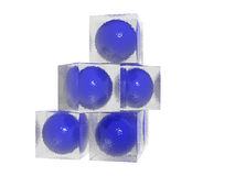 Glass boxes and blue balls. A set of glass boxes with blue balls inside Stock Image