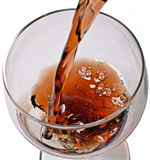 A glass of brandy. Pouring cognac into a glass royalty free stock photos