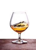 Glass of brandy. Glass with liquor shot over white Stock Image