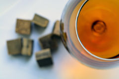 Glass of brandy and chocolate pieces Royalty Free Stock Photography