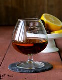 Glass of brandy with chocolate Stock Image