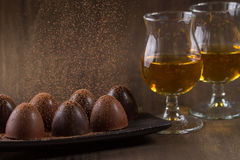 Glass of brandy with chocolate Stock Images