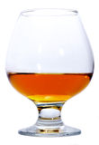 Glass of Brandy or Cognac. Snifter glass of Brandy isolated on white Stock Photography