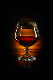 Glass of brandy and cork Royalty Free Stock Photos