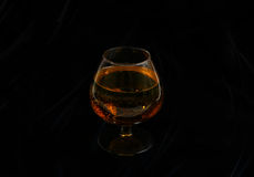Glass of brandy. On a dark background Royalty Free Stock Image