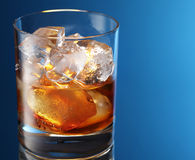 Glass of brandy with ice cubes Stock Photo