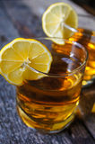Glass of brandy with lemon Royalty Free Stock Photo
