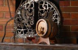 Glass of brandy near a fireplace Royalty Free Stock Photo
