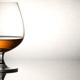 Glass of brandy over white Stock Photography