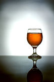 Glass of brandy with reflection Stock Photo