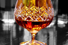 Glass of brandy selective color Stock Image