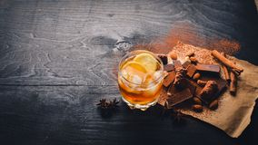 A glass of brandy. Whiskey. Assortment of chocolates Stock Photos
