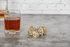 A glass of brandy or whiskey on a background of gray stone with truffles. Place for text.  stock photos