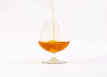 Glass of brandy. On a white background Stock Photography