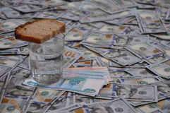 A glass with bread costs a lot of money stock photos