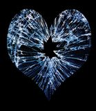 Glass break heart. Heart shaped shattered glass with a hole in the middle Royalty Free Stock Image