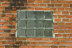 Glass brick. Optical glass brick on red wall for background Stock Photography